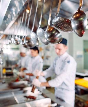 Modern kitchen. The chefs prepare meals in the restaurant's kitchen.