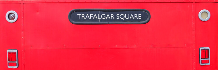 Street name sign on a red bus