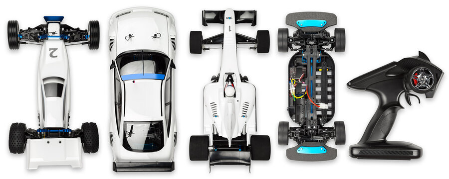 set collection of various types of remote controlled RC toy scale race cars like buggy touring and formula racing car with remote isolated white background