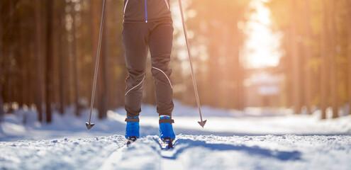 Fototapeta Cross country skiing Banner, winter sport on snowy track, sunset background obraz