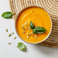 Pumpkin or carrot soup with basil greens