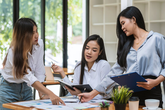 Group of young Asian businesswoman working at the office.