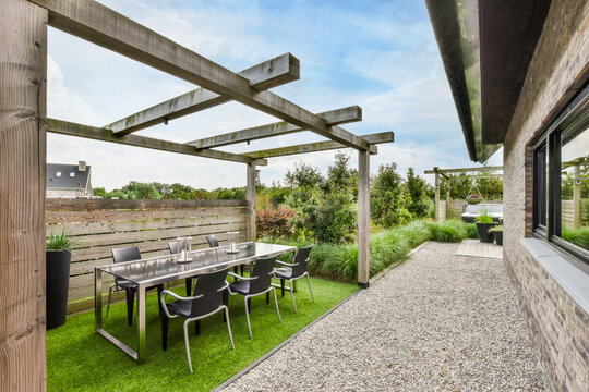 Backyard with dining table and chairs
