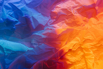 Abstract background with crumpled paper in neon gradient. Vivid blue, pink and orange colors