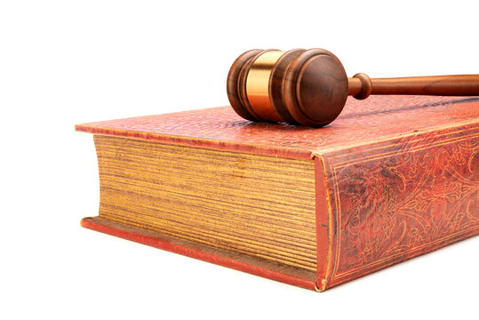 Gavel and handcuffs on law book