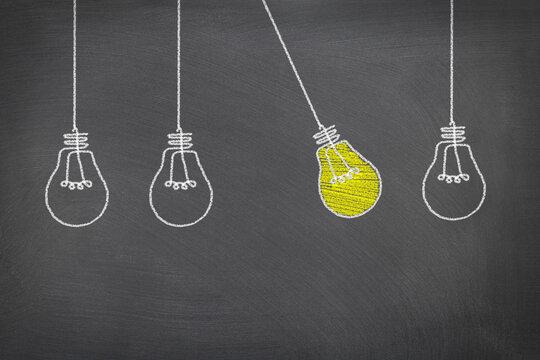Conceptual lightbulb drawn on chalkboard