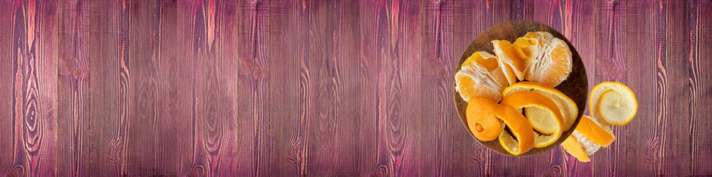 Orange Peel or Zest on Wood Desk Background