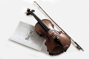 Violin and musical notes spreadsheet on a white surface