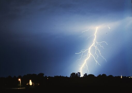 Lightning, cloud to ground, at night