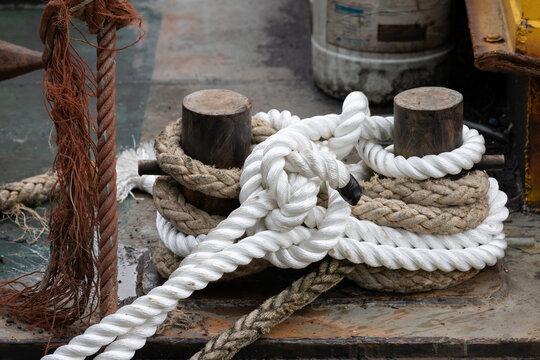 new rope on steel bollards at sea port.