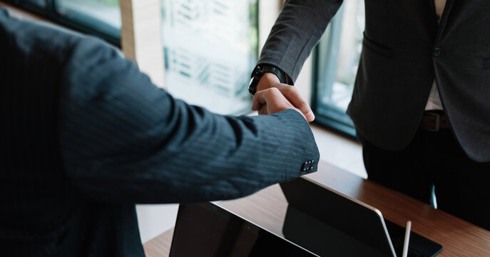 Businessman handshake for teamwork of business merger and acquisition,successful negotiate,hand shake,two businessman shake hand with partner to celebration partnership and business deal concept.