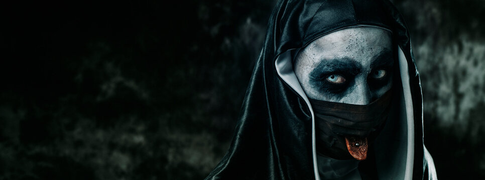 evil nun sticking out her tongue, web banner