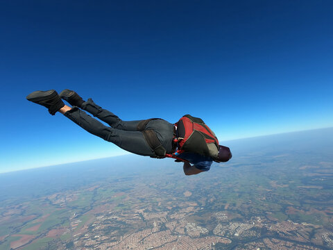 Parachutist performing a maneuver in a stretched body in free fall.