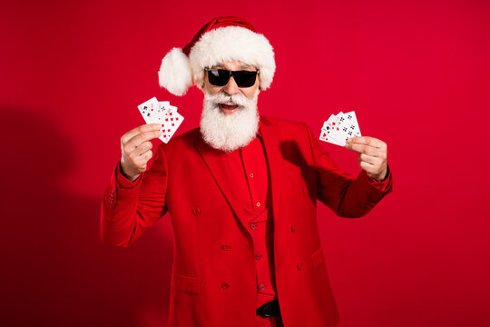 Photo of retired pensioner happy old man hold hands gamble card smile holiday celebrate isolated on red color background