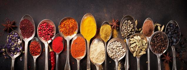 Fototapeta Various spices spoons on stone table. Top view obraz