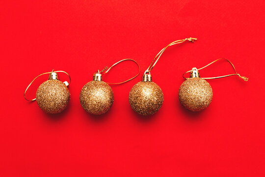 Gold Christmas balls on a red background