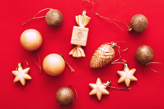 Gold Christmas balls and toys on a red background