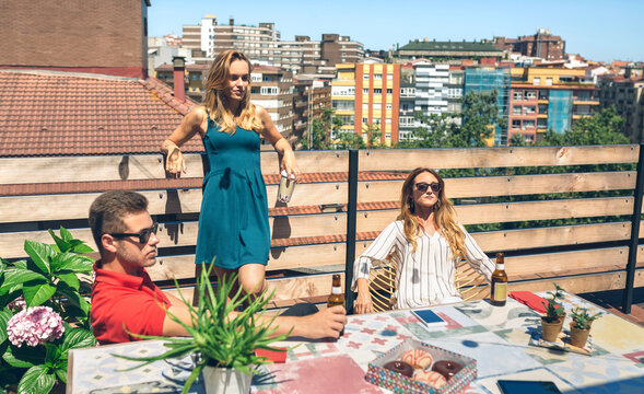 Group of friends drinking on a terrace