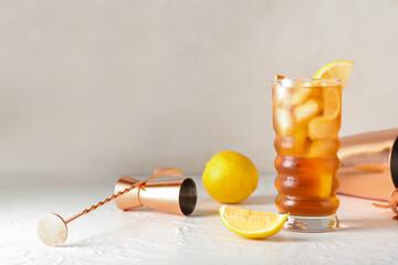Fototapeta Glass of tasty Long Island iced tea on light background obraz