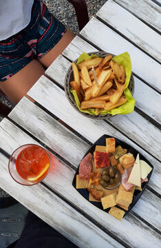 Spritz aperitif top view with chips. Italian lifestyle