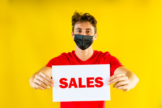 Boy with sales sign on yellow background. Clearance sale promo message