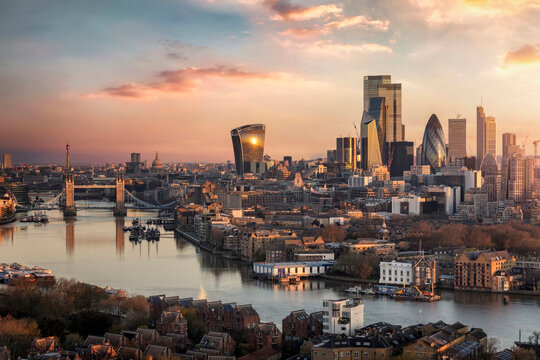 The skyline of London city with Tower Bridge and financial district skyscrapers during sunrise, England, United Kingdom
