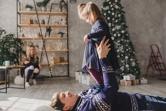 Happy family celebrating christmas at home