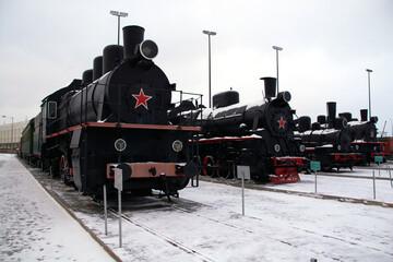 black Soviet steam locomotives at the old railway station.