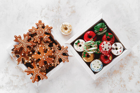 Christmas Cookie Boxes. Cardboard boxes with donuts and gingerbread as a gift. Top view, blank space