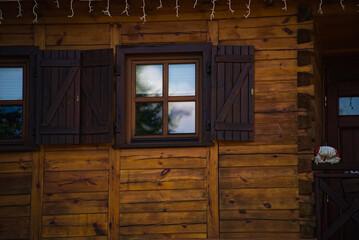 Fototapeta Okno , okiennica , drewniany dom . Window, shutter, wooden house. obraz