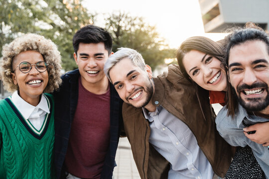 Portrait of happy young diverse friends having fun outdoor - Focus on hipster man face
