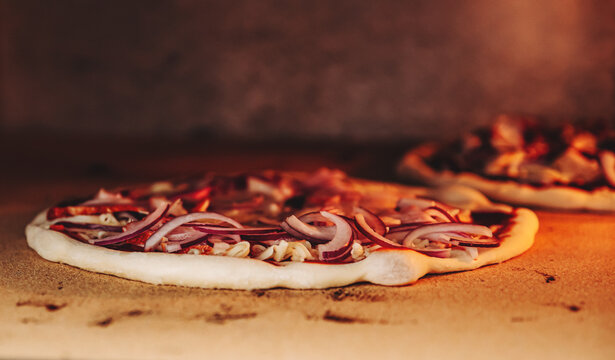 delicious pizza is baking in an oven