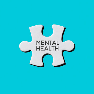 text mental health in a white puzzle piece