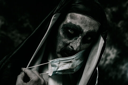 scary evil nun covers her mouth with a face mask