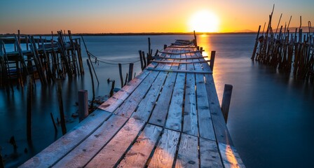 Old fishing pier at sunset in Portugal