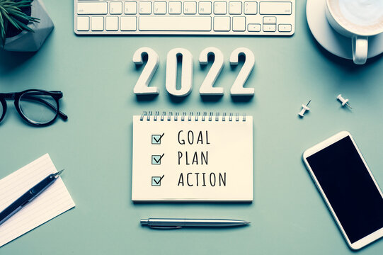 2022 new year goal,plan,action concepts with text on notepad and office accessories.