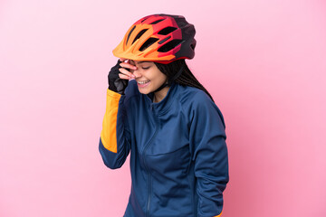 Fototapeta Teenager cyclist girl isolated on pink background laughing obraz