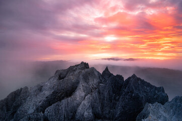 Aerial view Beautiful on rock of morning scenery Golden light sunrise And the mist flows on high mountains, Wonder fog. pang puay, Mae moh, Lampang, Thailand.