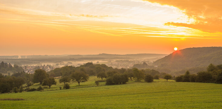 Landscape with the village of Longeville les Saint Avold at sunrise in Lorraine France