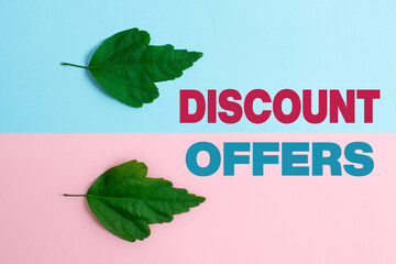 Text sign showing Discount Offers. Business idea amount or percentage deducted from the normal selling price Two Objects Arranged Facing Inward Outward On a Separated Coloured Background