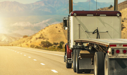 Fototapeta Semi Truck with Flatbed Trailer on a Scenic Utah Road obraz
