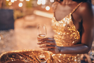 Obraz Close-up of beautiful young African woman in evening gown holding flute with champagne - fototapety do salonu