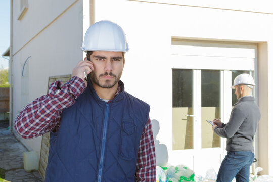 supervising a construction using cell phone outdoors