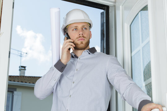 architect on telephone as he enters a property