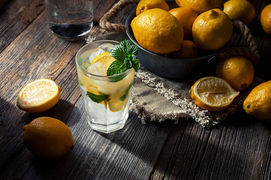 coctail and lemons on wood background