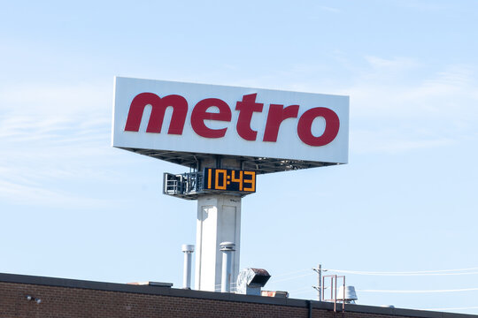 Etobicoke, Toronto, Canada - September 26, 2021: Close up of Metro sign with blue sky in background at their warehouse in Etobicoke, Toronto, Canada. Metro Inc. is a Canadian food retailer.