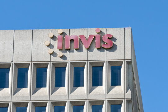 Etobicoke, Toronto, Canada - September 26, 2021: Close up of Invis sign on the building in Etobicoke, ON, Canada. Invis is a Canadian national mortgage brokerages.
