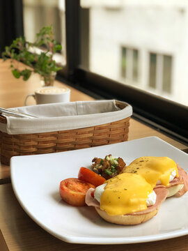 Breakfast made with eggs and chips, set up and decorated with red tomatoes for breakfast with copy space