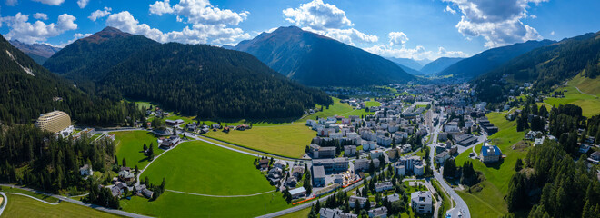 Aerial view around the city Davos in Switzerland on a sunny day in summer.