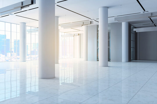 Empty white concrete hall interior with columns, city view, daylight and reflections on floor. 3D Rendering.